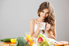 Young cute girl having breakfast Royalty Free Stock Images