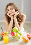 Young cute girl having breakfast Royalty Free Stock Photography