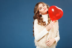 Young cute girl with heart-shaped ballon Stock Image