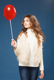 Young cute girl with heart-shaped ballon Royalty Free Stock Photo