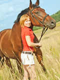 Young cute girl  with her horse Stock Photography