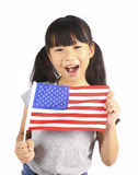 Young cute girl holding an American Flag Stock Photography