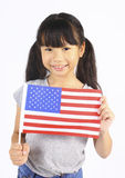 Young cute girl holding an American Flag Royalty Free Stock Photos