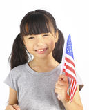 Young cute girl holding an American Flag Stock Photos