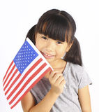 Young cute girl holding an American Flag Royalty Free Stock Images