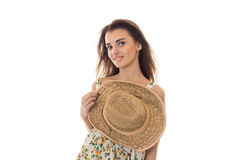 Young cute girl holding hand hat and looks at the camera Stock Image