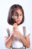 Young cute girl holding magnifying stock images