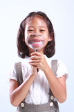 Young cute girl holding magnifying royalty free stock image
