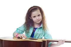 Young girl and guitar Royalty Free Stock Photography