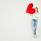 Young Cute Girl Holding Red Heart for Valentine's Day Stock Photos