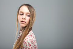 Young cute girl with long brown hair. Young beautiful girl in blouse with a pattern of flowers. Long brown straight hair. Languishing look Royalty Free Stock Image