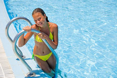 The young cute girl at pool. The young girl at pool Royalty Free Stock Images