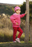Young cute girl posing in the park Stock Photo