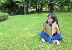 Young cute girl reading. Stock Image