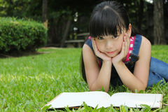 Young cute girl reading. Stock Photography