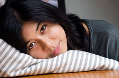 Young cute girl resting on soft pillow Stock Image