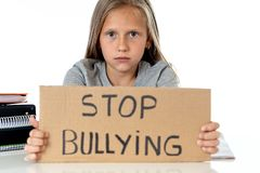 Young cute girl in school bullying abuse concept stock photos