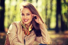Young  girl smiling in autumn park. Stock Images