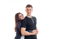 Young cute girl smiling and hugging beautiful high guy Stock Image