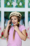Young cute girl speaks on cell phone Stock Photos