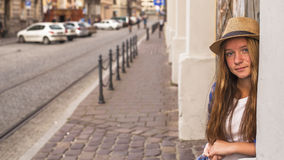 Young cute girl standing in the street old town. Travel. Royalty Free Stock Images