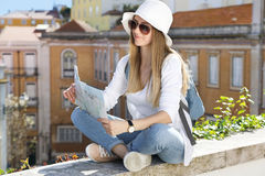 Young cute girl with a tourist map Royalty Free Stock Photos