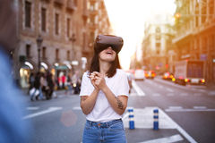 Young cute girl uses virtual reality Stock Images