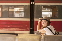 Young cute girl is waiting train on the platform. Travel. Stock Photos