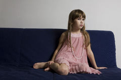 Young cute girl is wearing fashionable dress Royalty Free Stock Photography