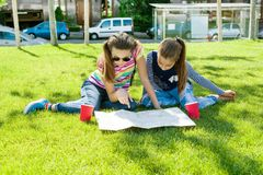 Young cute girls teens with map of european city outdoors Royalty Free Stock Photo