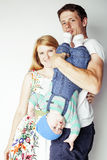 Young cute happy modern family, mother father son  on white background, lifestyle people concept Stock Photography