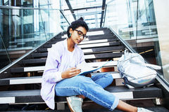 Young cute indian girl at university building sitting on stairs Stock Image