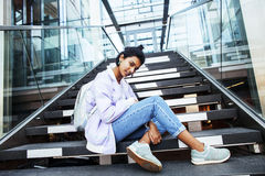 Young cute indian girl at university building sitting on stairs Royalty Free Stock Photos