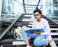 Young cute indian girl at university building sitting on stairs Royalty Free Stock Photography