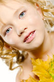 Young cute little girl with orange autumn leaves Royalty Free Stock Photos