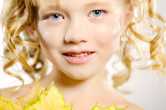 Young cute little girl with orange autumn leaves Stock Photo