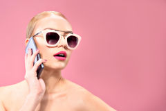 Young cute model using mobile phone Stock Photos