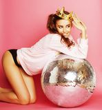 Young cute party girl like barbie on pink. Background with disco ball and crown smiling royalty free stock photos