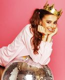 Young cute party girl like barbie on pink. Background with disco ball and crown smiling stock image