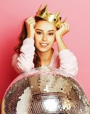 Young cute party girl like barbie on pink. Background with disco ball and crown smiling stock photos