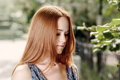 Young cute red haired women outdoors in calm state Royalty Free Stock Photos