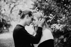 Young Cute Romantic Beautiful Loving Couple Face to Face Looking into Each Others Eyes Outside in Nature stock images