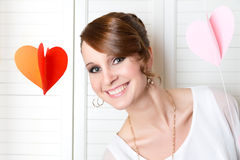 Young cute smiling girl. With hart decorations Royalty Free Stock Photo