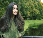 Young cute smiling woman in green park , lifestyle concept happy people. Closeup royalty free stock photo