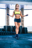 Young cute sporty woman workout with jumping rope Royalty Free Stock Image