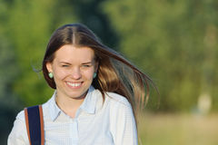 Young cute student with bag in the park near campus Stock Images
