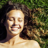 Young cute summer girl on green grass outside Stock Photography