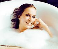 Young cute sweet brunette woman taking bath, happy smiling peopl Royalty Free Stock Photography
