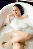 Young cute sweet brunette woman taking bath, happy smiling people concept Royalty Free Stock Images