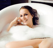 Young cute sweet brunette woman taking bath, happy smiling people concept Stock Photo